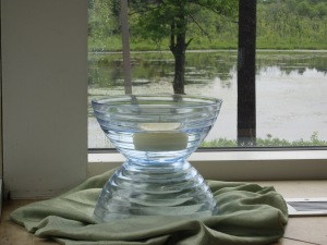 A floating candle in a pair of inverted bowls add light and interesting reflective surfaces to an already serene view.